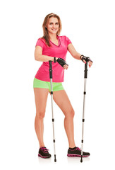 Nordic walking athletic woman posing on white background