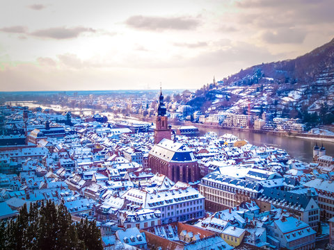 Aerial view of Heidelberg town and Neckar river in winter with snow from the castle in the Baden-Wurttemberg region of southwest Black Forest in Germany during winter Christmas time