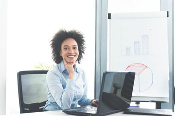 Businesswoman working online in her office