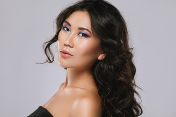 Young asian woman with a beautiful curly hair and make-up