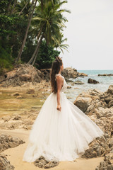 Bride wearing beautiful wedding dress on the tropical beach