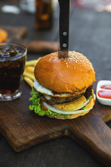 Delicious burger with beef, egg and pineapple