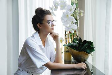 Young and beautiful businesswoman wearing white shirt