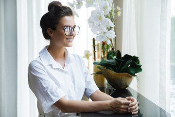 Businesswoman in white shirt in the office