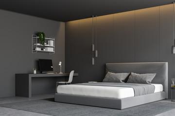Gray bedroom corner with computer desk