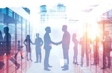 Handshake of business people in city