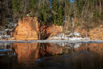 sandstone cliffs on the shore of river Gauja in Latvia
