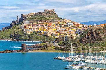Picturesque view of Medieval town of Castelsardo, province of Sassari, Sardinia, Italy. Popular travel destination. Sea port on the foreground. Mediterranean seacoast