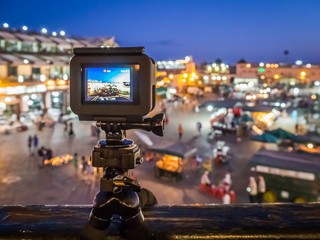 Action camera record timelapse view of a famous market in Marrakech in Morrocco