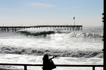 Ventura California Pier during super tide in winter on bright day