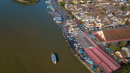 Panorama of Hoian market. Aerial view of Hoi An old town or Hoian ancient town. Royalty high-quality free stock photo image top view of Hoai river and boat traffic in HoiAn market. Hoian city, Vietnam