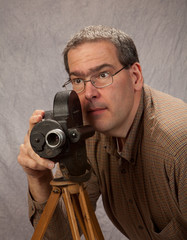 Middle Age Man with vintage movie camera