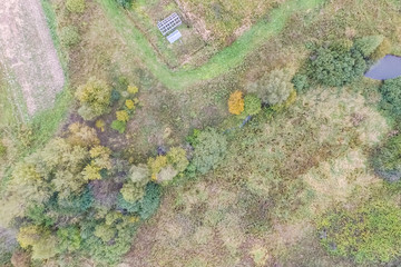 Top view of a field overgrown with grass. Unplowed field.