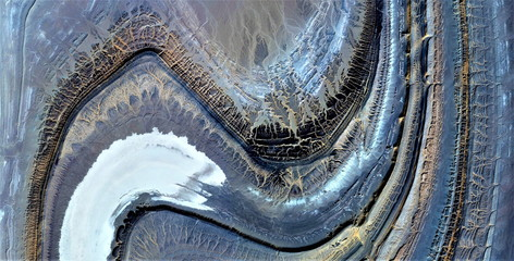 dangerous curve, tribute to Pollock, abstract photography of the deserts of Africa from the air, aerial view, abstract expressionism, contemporary photographic art,