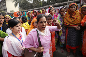 A garment workers shout as they protest for higher wages in Dhaka