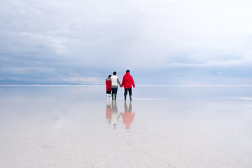 Family in Uyuni Lake at the first day of New Year