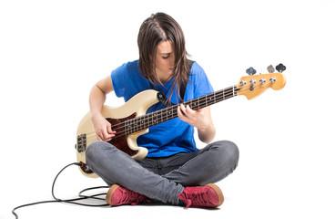 Beautiful rock girl playing bass guitar