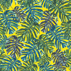 Seamless tropical monstera leaves and flowers pattern, jungle print design. Pattern on yellow background. Fashion trended tropical background.
