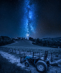 Milky way over vines and old tractor a night, Tuscany
