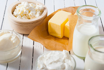 homemade dairy product samples on white wood table background