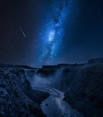 Stunning Dettifoss waterfall and milky way in Iceland at night