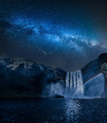 Stunning milky way and waterfall Skogafoss in Iceland at night