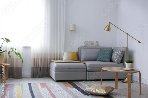 Modern Living Room Interior With Comfortable Sofa Near Window Stock