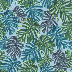 Seamless tropical monstera leaves and flowers pattern, jungle print design. Pattern on light blue background. Fashion trended tropical background.