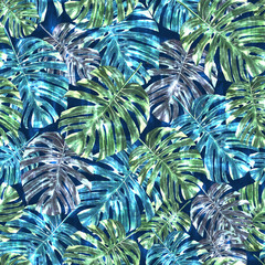 Seamless tropical monstera leaves and flowers pattern, jungle print design. Pattern on navy blue background. Fashion trended tropical background.