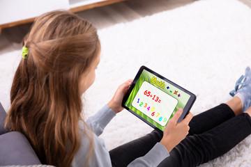 Girl Solving Math On Digital Tablet
