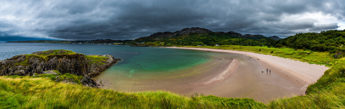 White Sand Beach With Green Ocean Water And Golf Course At Gairloch In Scotland