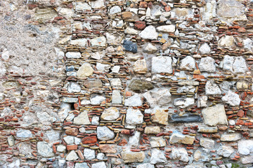 Patterns and textures of rock, stones and mortar in vintage street and wall construction in Sicily