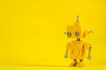 Robot on a yellow background. Wall mural