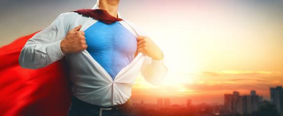 superhero businessman looking at city Wall mural