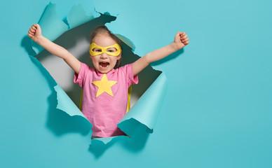 Fototapeta child playing superhero