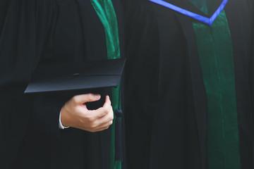 graduation,Student hold hats in hand during commencement success graduates of the university,Concept education congratulation.Graduation Ceremony,Congratulate the graduates in University.