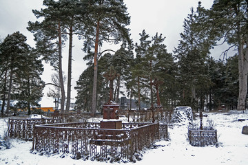Very old christian cemetery in winter day
