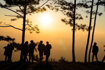 Image of black silhouette of people watching the sunrise on colorful horizon ( Phu kradueng thailand )