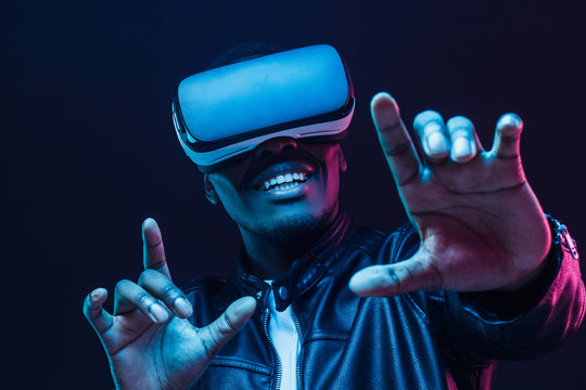African man wearing virtual reality headset having great fun