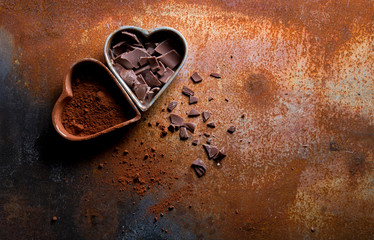 Kitchen mold in the shape of a heart on a rustic background.