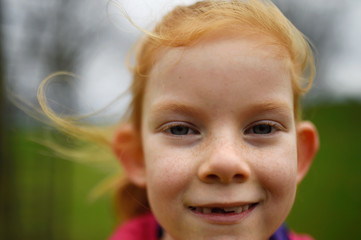 Aishling Griffiths, aged 7, poses for a photograph to celebrate 'Kiss a Ginger Day' on the 10-year anniversary of this anti-bullying day, in Dublin