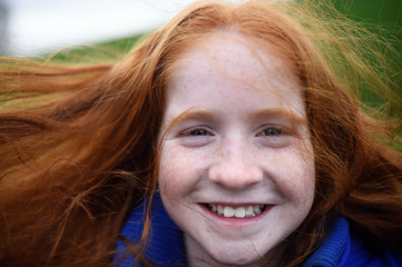 Hollie Herridge, aged 10, poses for a photograph to celebrate 'Kiss a Ginger Day' on the 10-year anniversary of this anti-bullying day, in Dublin