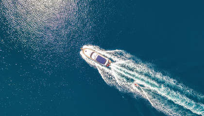 Yacht on the sea from top view. Aerail view at the boats. Sea background from top view. Summer seascape from air. Travel concept and idea