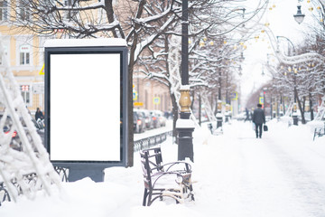 Vertical mock-up of city poster winter city with thick edges, blank white billboard in urban settings, empty street information placeholder on sidewalk with copy space for logo, advertising Fotomurales