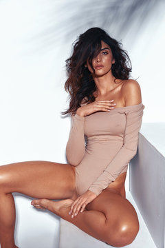 Portrait of a sensual latina lady with long, tanned legs