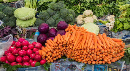 Istanbul, Turkey / May 31, 2016 - Carrots, radishes, onions and other vegetables are on display