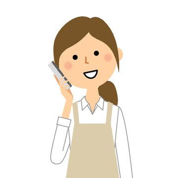 エプロンの女性 電話