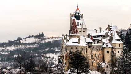 Bran Castle, Romania. Stunning view on a cold snowy day, twilight image of Dracula fortress in Transylvania, medieval landmark. Also know as Dracula`s house.