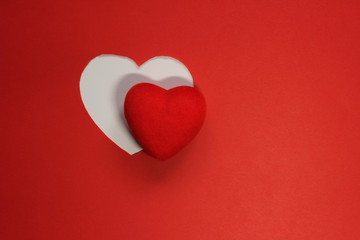 Red Paper Background for design to Valentine's Day. Decorative heart from red felt. View from above. Valentines Day concept