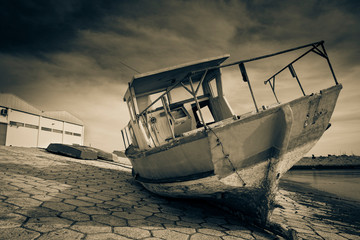 monochrome of an old damaged and abandoned fishing boat